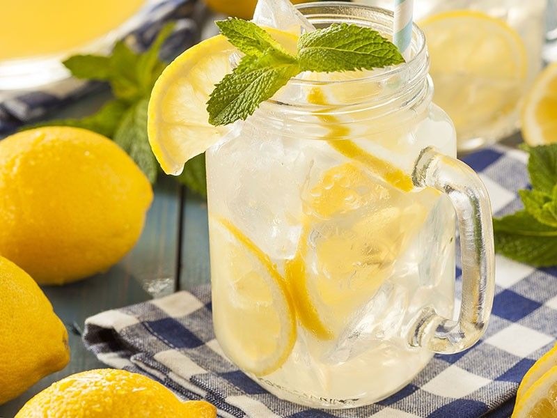 Homemade Refreshing Yellow Lemonade with Ice and Mint