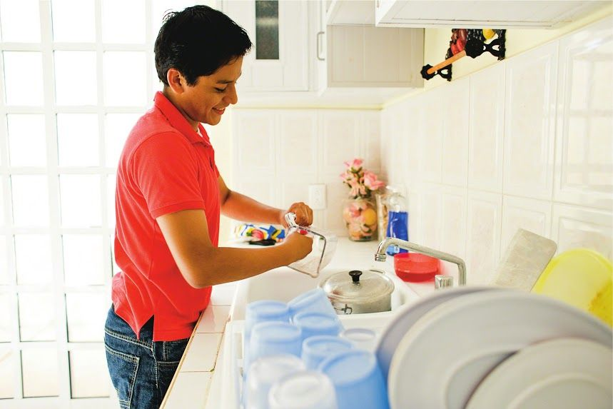 young-latino-man-washing-dishes