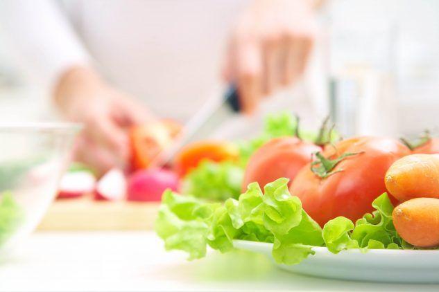 Hands cooking vegetables salad