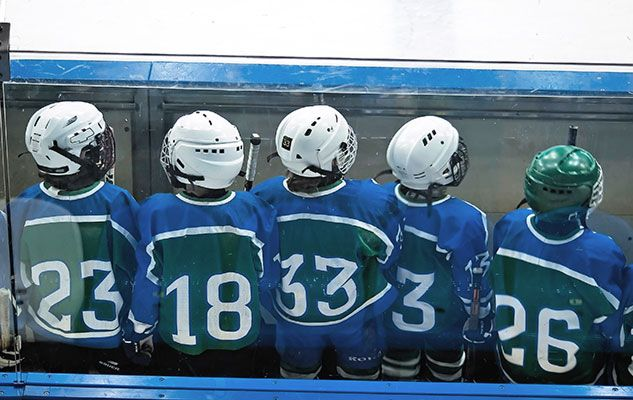 people,-hockey-player-boys-behind-boards